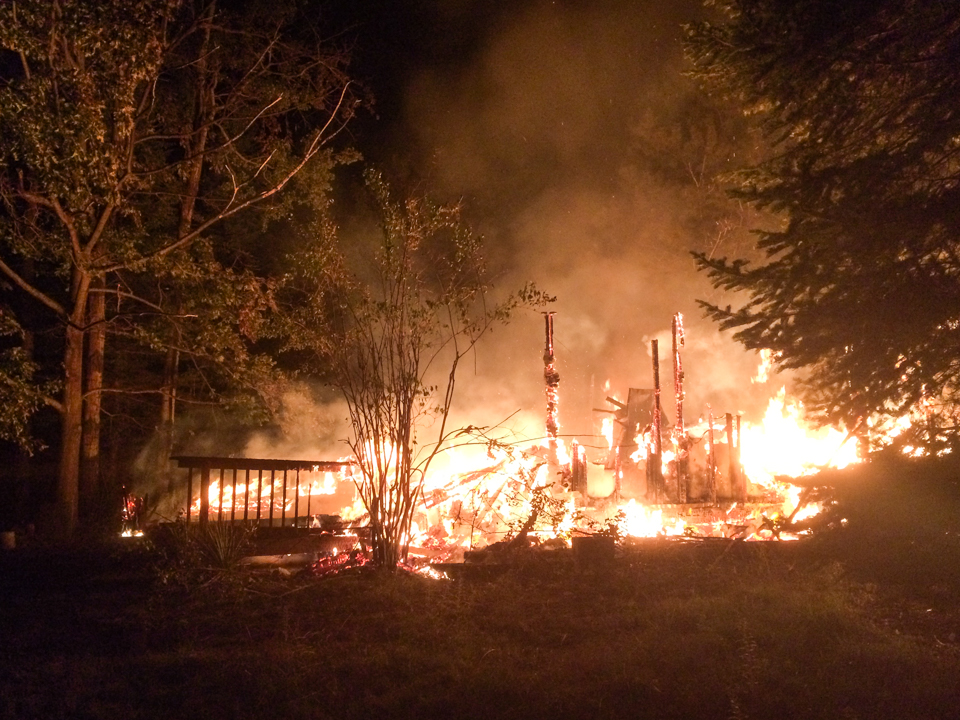 Image of burning structure.