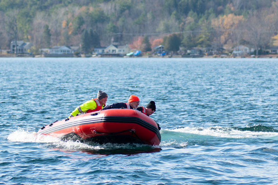 Image of rescue team in boat on lake.